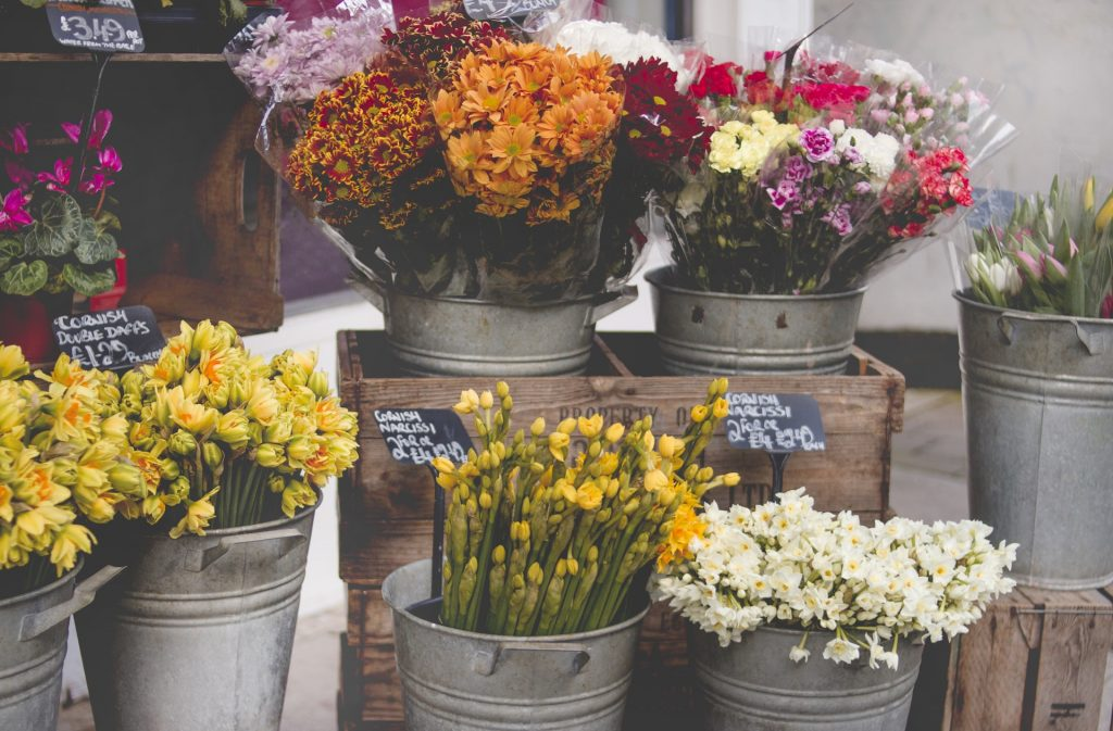 picture of flowers in buckets on display at a florist