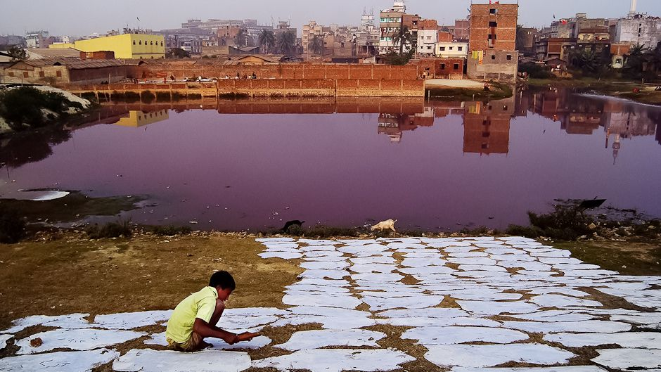 purple lake in Dhaka, Bangladesh as a result of chemicals from tanneries for leather production