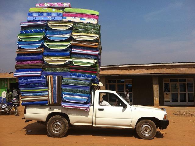 van overloaded with a pile of mattresses in rwanda