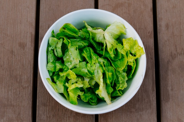 green leaves in a bowl