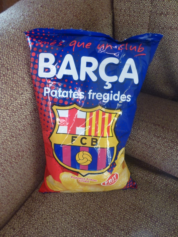 bag of potato crisps on a sofa