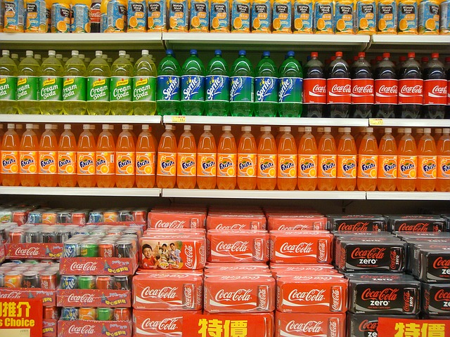 A supermarket aisle of soft drinks