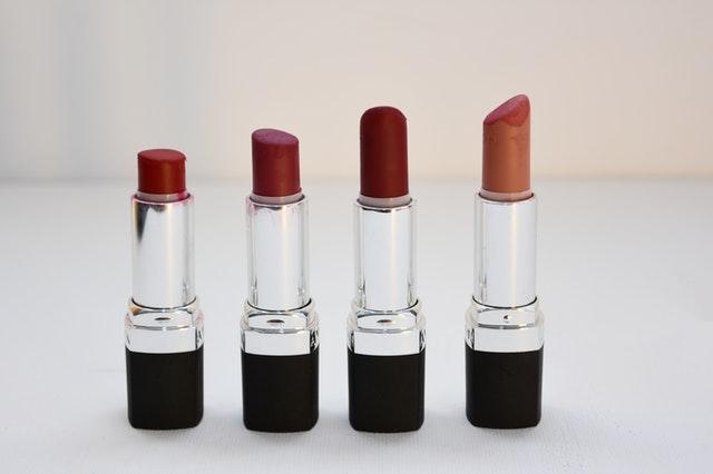 4 lipsticks upright in a line