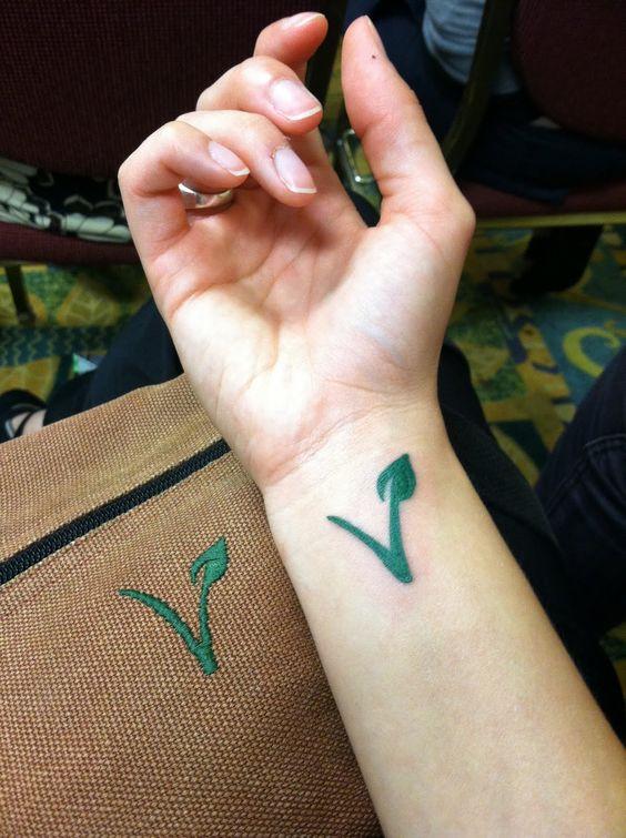 Vegan logo tattoo on wrist